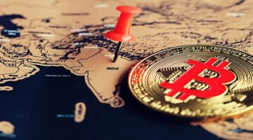 A coin and pin on a world map